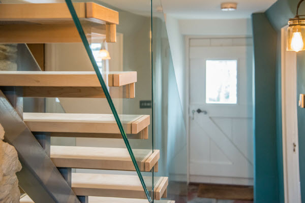 The bespoke glass staircase we built at Staddon House.